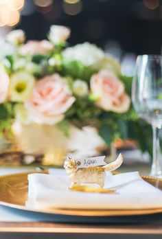 Place Card Ideas: Tiny gold animal figurines with personalized guest tags.