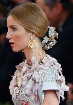 Annabelle Wallis rocked a chignon covered in metallic flowers at the Met Gala. The look would be perfect for a wedding.