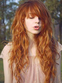 Pretty curly light auburn hair