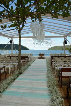 9 Simple Ways to Pull Off a Cool Beach Wedding--gorgeous wedding ceremony with crystal chandellier and baby breath lined aisle, Chapel Wedding, Wedding Ceremony, Wedding Venues, Destination Wedding, Outdoor Ceremony, Wedding Dress, Wedding Goals, Dream Wedding, Wedding Stuff