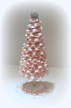 Shabby Chic Christmas Tree. Humm...I'm thinking ruffled lace glued on a foam cone with a rhinestone pin at the top.