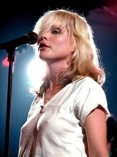 """Pictured here is Debbie Harry, better known as """"Blondie,"""" on stage back in The iconic new wave singer is also considered the first female rapper to chart at number one in the United States because of her work on Rapture. Blondie Debbie Harry, Debbie Harry Hot, Women Of Rock, Female Singers, Gi Joe, Rock And Roll, Beautiful Women, Thing 1, Hollywood"""