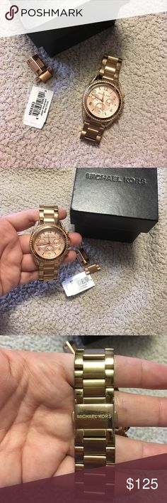 Michael Kors Blair chronograph 38mm rosegold watch Its been used. Has tarnishes and scratches as photographed. Please let me know if you have any questions or would like to see additional photos. I photographed it to the best of my ability. Comes with box, tag and extra links. NO MISSING RHINESTONES. Just had the battery replaced a few months ago. Michael Kors Accessories Watches