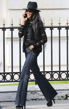 Leggy: Naomi Campbell looked leggy in her jeans when she had lunch at an Italian restaurant Stresa with some friends before going shopping o...