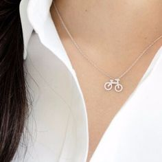 Roll out in this small bike charm necklace. Complete the look with the matching earrings.