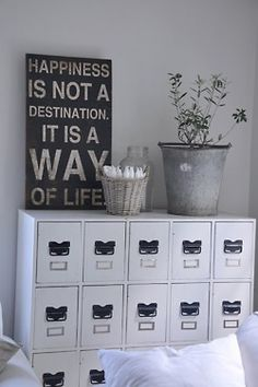 office craft room storage. sign - hapiness is a way of life.