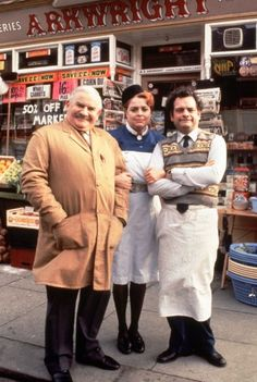Open All Hours: Ronnie Barker as Arkwright with his assistant, Granville (David Jason) and buxom Nurse Gladys Emmanuel (Lynda Baron)