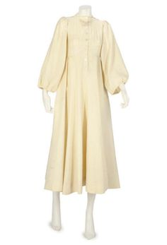 Jean Muir, an ivory wool gown. Full skirted dress with bishop sleeves. Button placket to the front (Jean Muir London label). Sale 5286;Lot 103----Christie's Large Image