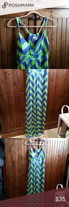 Allison Brittney Dress It is a blue and green zebra based pattern. It is a size Large and it is great for people who are either tall or who love to wear heels! It's been worn only once and it is in good condition. Allison Brittney Dresses Maxi