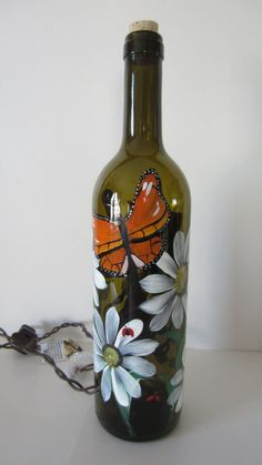 Butterfly Daisy Lady Bug Amber Lighted Wine by EverythingPainted Wine Bottle Glasses, Wine Bottle Art, Painted Wine Bottles, Lighted Wine Bottles, Diy Bottle, Painted Wine Glasses, Wine Bottle Design, Glass Bottle Crafts, Bottle Painting