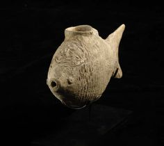 Middle-New Kingdom Terracotta Vessel in the Form of a Fish. Origin: Egypt  Circa: 2300 BC to 1300 BC  Collection: Egyptian Antiquities  Style: NewKingdom  Medium: Terracotta  Condition: Very Fine