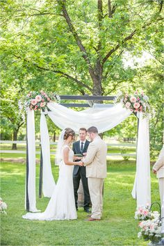 A Glam Country Wedding in Phoenix, Arizona with loose blush florals and a white draped ceremony arbor arch in a pecan grove - Photos by Drew Brashler Photography
