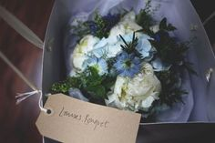 Beautiful pale blue wedding flowers by Scarlet and Violet, London