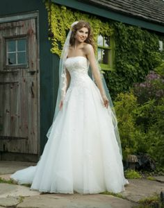 Dress of the week: 3637  This strapless tulle dress has a beaded lace top that falls into the drop waist bodice. Its corset back and chapel length train makes it a sight to see whether you're looking at the front or the back. The wedding dress is shown in ivory but it is also available in white.    Sincerity Bridal wedding dress