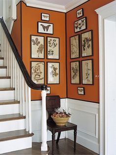 Hermes Orange Walls, Black Ribbon detail, and you've created a Handsome Hermes Box Foyer.