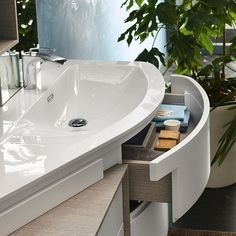 Closer look at the delightful storage units inside Avantgarde by Inda | Giving Contemporary Bathrooms a Curvy Twist | www.bocadolobo.com #bocadolobo #luxuryfurniture #luxurydesign #bespoke #furnituredesign