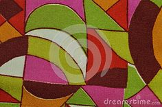 A sample of bright fabrics with geometric, abstract pattern with a predominance of yellow-green shades.
