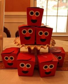 Chinese take-out containers decorated with the face of Elmo.  See more Elmo birthday party ideas at www.one-stop-party-ideas.com