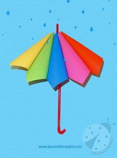 Ombrello con coni di carta colorata