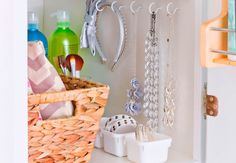 Use hooks in the bathroom closet or inside the medicine cabinet to hang your ~fave~ accessories.   15 Genius Dollar Store Bathroom Hacks Because Mess = Stress