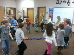 """♫ We ❤ Music @ HSES! ♫: """"March"""" from the Nutcracker. I saw this done at a conference! I want this stretchy rope! Music Lessons For Kids, Music Lesson Plans, Music For Kids, Children Music, Fun Songs, Kids Songs, Music Activities, Music Games, Sensory Games"""