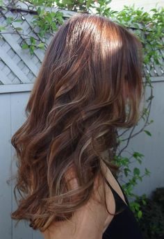 Gorgeous highlights on light brown curly hair