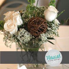 Centerpiece by Fleurish Floral Design | White Roses, Belles of Ireland, White Trachelium, Italian Ruscus, Dinosaur Grass, and a vine ball