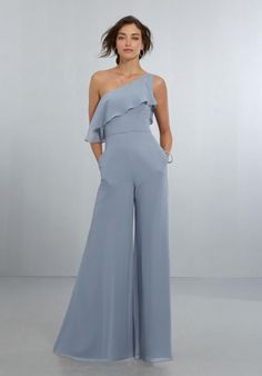 Bridesmaid Gowns Morilee Bridesmaids 21574 One Shoulder Chiffon Bridesmaid Jumpsuit - Chic, One-Shoulder Jumpsuit with Wide Legs and Soft Front and Back Flounce, Finished Off with a Back Zipper. Mori Lee Bridesmaid Dresses, Bridesmaid Jumpsuits, Bridesmaid Outfit, Wedding Dresses, Bridal Gowns, Gown Wedding, Red Wedding, Bride Dresses, Wedding Bridesmaids