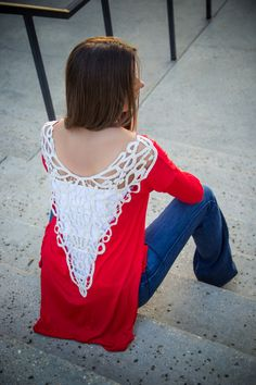Take a beautiful Red top that in itself has style and then turn around to a gorgeous lace detail back equals jaw dropping!  We love the double side slits with this tunic style top making it easy to wear like a true fashionista.