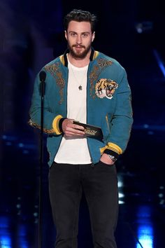 Aaron Taylor-Johnson speak onstage during the 2017 MTV Movie And...