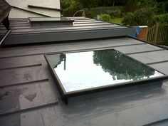 Single ply membrane roof with flat roof light. A little uninspiring but cost effective. Flat Roof Skylights, Zinc Cladding, Porch Uk, Fibreglass Roof, Garage Renovation, Roof Window, Roof Structure, London House, Roof Light