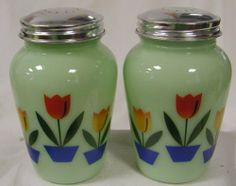 Classic Round Jade Glass Salt & Pepper Set with Tulips Metal Lids . $24.00. Set of Jade Glass Salt and Pepper Shakers.  They are decorated with Tulip Flowers.  This is cast in a green milk glass. Also known as Jade or Jadiete.  The metal lids highlight the color and the style.. Save 40%!