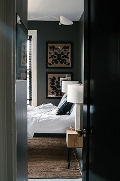 Home Interior 2019 BHDM Design via Lonny - handsome colors. Love the shiny black door. and the art, and the white. It& all in the details. Grey Bedroom Design, Grey Bedroom With Pop Of Color, Gray Bedroom, Trendy Bedroom, Bedroom Colors, Home Bedroom, Bedroom Decor, Bedroom Designs, Master Bedroom