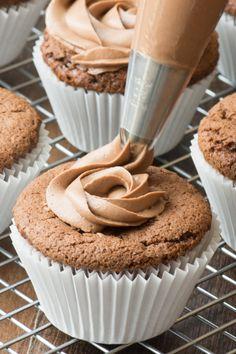 Nutella buttercream bing piped onto a Nutella cupcake.