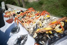 Why not try something different? In order to cater to all taste buds, set up food stations around for guests to choose from.  Make sure to have a pretty extravagant seafood station!