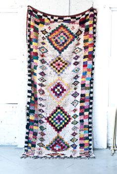 One of our vibrant Boucherouite Rugs that came straight from the souks in Morocco! This is one of our favorites!