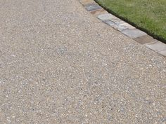 exposed aggregate concrete patio with pavers. Want this as a small patio on front of our house.