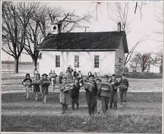 ~Students, 1950, in Riley Tws., Ohio leaving their one room school house for their new school across the field~