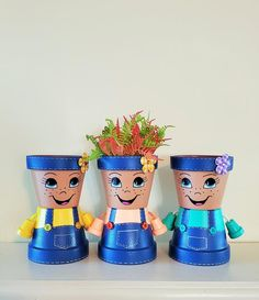 Flower Pot Art, Clay Flower Pots, Clay Pots, Flower Pot People, Clay Pot People, Clay Pot Projects, Clay Pot Crafts, Shell Crafts, Painted Pots