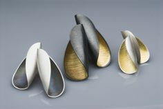 Jane Adam - open pod earstuds: silver and gold bimetal with oxidisation.  Size on left: 30x15mm