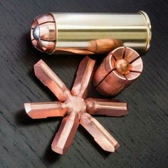 "New brass cased hollow point 12 gauge shotgun shell by Oath Ammo. It can expand 2.5"", literally the size of a fist."
