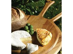 Gorgeous acacia cheese board from @greenbrideguide!