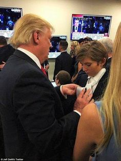 Donald Trump showing Barron Trump how to tie his tie on election night. - Nice photo!
