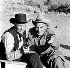 RIDE THE HIGH COUNTRY (1963) - Joel McCrea & Randolph Scott take aim on the set between scenes - Directed by Sam Peckinpah - MGM - Publicity Still.