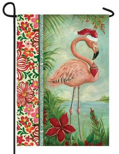 Tropical Christmas pink flamingo themed garden flag, featuring a colorfularrangement of red and pink flowers and a graceful flamingo sporting a Santa hat and Christmas tree ornament.Celebrate the Ho