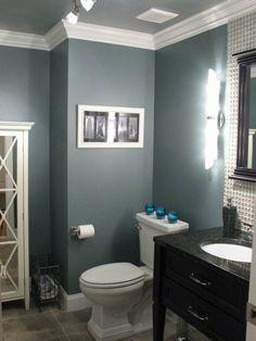 Smokestack Gray - Benjamin Moore Must have bathroom. Love the detail behind the mirror!