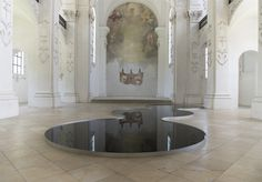 Glassy Pools of Used Motor Oil Reflect the Architectural Splendor of a Swiss Church