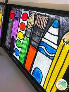 Paintbrush, marker, paint palette, crayon, oil pastel, and pencil window painting in the art room