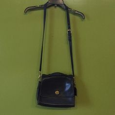 """Vintage Coach saddlebag Classic! Authentic Coach. This bag is a staple. Big enough for a paperback but small enough for a night out. Some wear on back and interior, but otherwise looks and feels great. Coach tags still on. 9"""" x 7"""". 2"""" deep! Vintage Bags Crossbody Bags"""