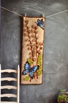 Vintage Handmade Latch Hook Rug Wall Hanging Blue Butterflies and Pussy Willow Branches. $45,00, via Etsy.